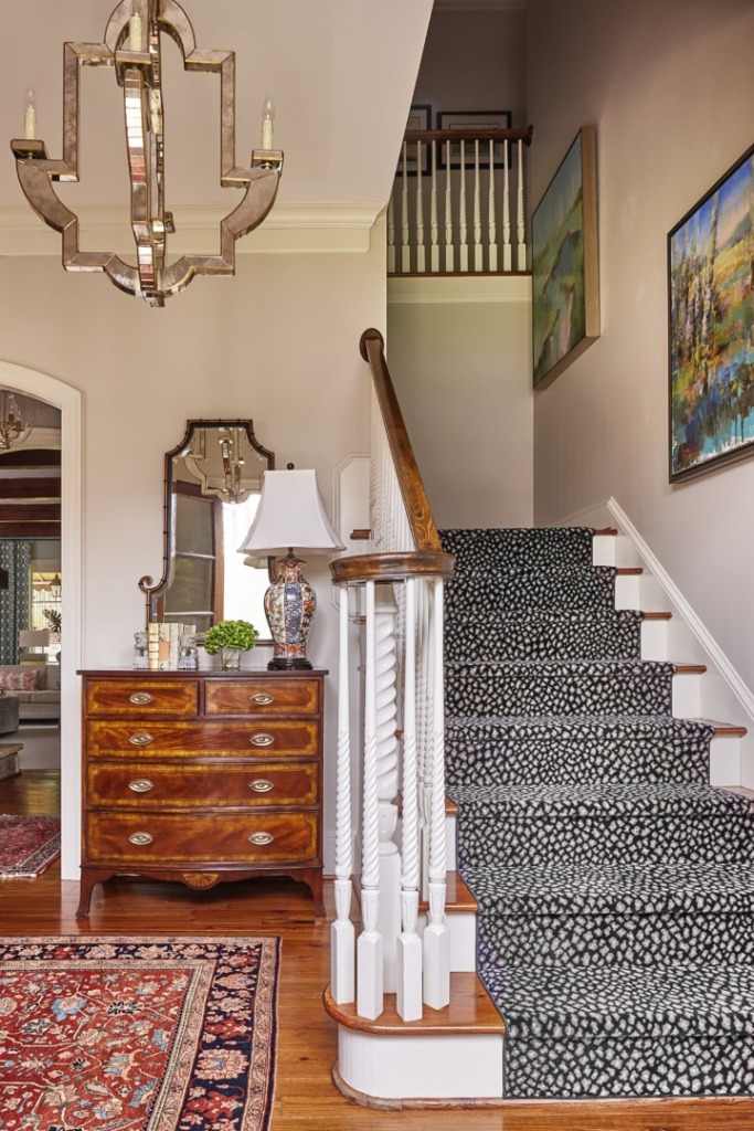 Photo of a modern foyer with the view leading up the stairs